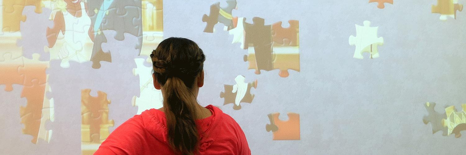 woman doing a puzzle on a smart board