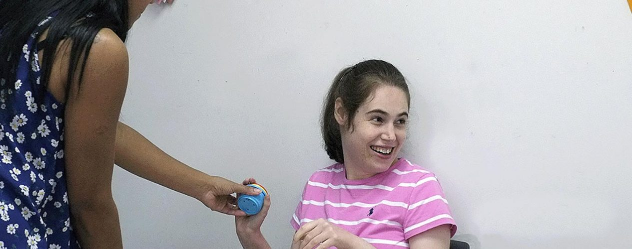 woman in autism services program doing occupational therapy